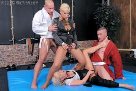 Babes quench their thirst with piss from two horny judokas