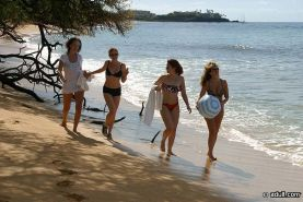 Four lesbians on a Hawaiian beach