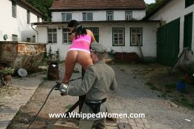 Whipped and cropped on pillory