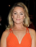 Elisabeth Rohm wearing low cut orange dress at 25th annual Palm Springs Internat