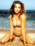 Kelly Brook showing her nice big tits and posing very sexy nude