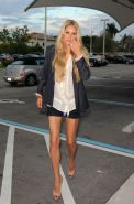 Anna Kournikova leggy in shorts at David Popes's book release party