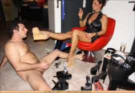 Kinky german mistress gets her feet licked by a slave