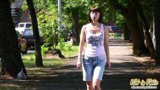 Confused girl in the shorts reveals her wet legs and nasty urine spot