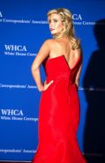 Ivanka Trump shows huge cleavage wearing a strapless red dress at the 101st Whit