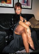 Lady in latex coat displaying her legs