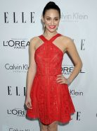 Emmy Rossum braless wearing red slightly see-through mini dress at ELLE's 20th A