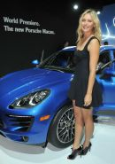 Maria Sharapova cleavy and leggy wearing black mini dress at Porsche Macan World