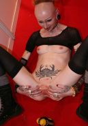 extreme pierced and tattoo babe pee in the toilet