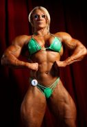 Huge blonde Female Bodybuilder ripped shredded muscles