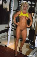 Sexy body builder training in the gym