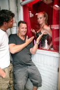 An Amsterdam prostitute gets facialized by a happy customer