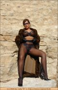 Kinky lady posing in pantyhose and fur outdoor