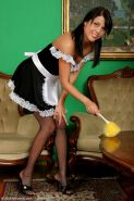 Beautiful older brunette as french maid with white panties