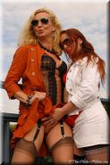 Two mature lesbians in stockings having fun outdoors