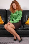 Redhead lady Claire stretching her stockinged legs