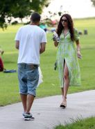 Eliza Doolittle upskirt wearing wide open green floral dress at the park in Lond