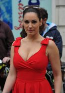 Kelly Brook shows huge cleavage while cycling in low cut red dress at Sky Ride i
