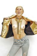 Miley Cyrus posing topless showing her hot Boobs