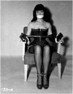 Retro bondage pics with Bettie Page that were made and collected in 60s