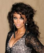 Tyra Banks showing huge cleavage at the 2013 CBS/CW/Showtime Summer TCA Party