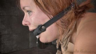 Claire Robbins is mouth fucked in bondage