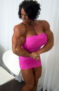 Massive female bodybuilder flexing her truly huge muscles