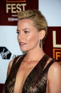 Beautiful Elizabeth Banks showing huge cleavage in low cut shiny mini dress at P