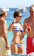Maria Menounos shows off her curvy body wearing Greek-flag striped bikini at the