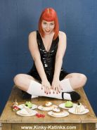Latex girl gets messy with food