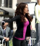 Megan Fox cleavy wearing tight outfit while jumps on trampoline at the TMNT set
