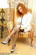 Mature german redhead lady Claire shows off her sexy legs