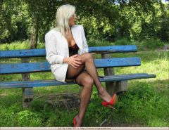 Milf in black lingerie and stockings posing in the park