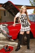 Blonde teen Crista Moore poses next to the hot rod
