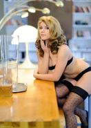 Betty on a bar stool in black stockings