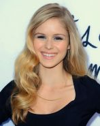 Erin Moriarty shows big cleavage wearing sexy black mini dress at The Kings of S