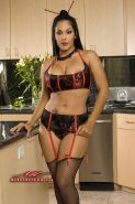 Hot Latina Pornstar Nina Mercedez dressed in her fishnets and asian garters want
