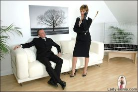 Business woman sucks cock while talking on the phone