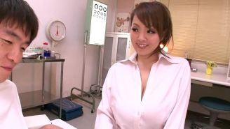 Busty asian Hitomi Tanaka tit fucking a guy with her monster tits