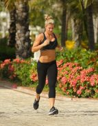 Gemma Atkinson busty and booty in black sports bra and tights during morning jog