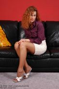 Redhead lady Claire in brown stockings