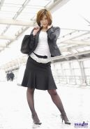 A japanese idol in black pantyhose and lady business suit
