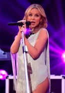Kylie Minogue leggy in a nasty short dress performing on BBC