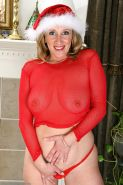 Naturally busty mature with big ass strips off her xmas outfit