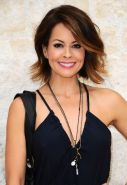 Brooke Burke shows pokies braless in low cut and high slit dress at Michael Simo