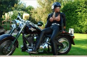 Biker slut Barbara in latex with bonded tits