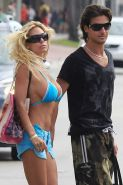 Shauna Sand looking sexy in blue bikini on beach and flashing pussy and tits pap