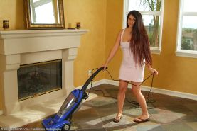 brunette housewife gets carried away with the vaccuum cleaner