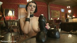 Cherry Torn bdsm slave is fucked with huge dildo and sucking cum