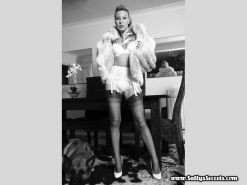 Retro Saffy in glamour lingerie and fur smoking cigar
